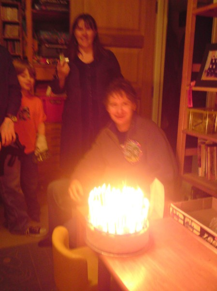 Michael behind an impossibly bright Birthday Cake