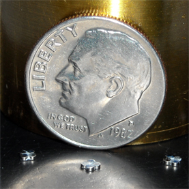There are three magnetic mini-robots in front of the coin - can you see them? Picture courtesy of Scientific American