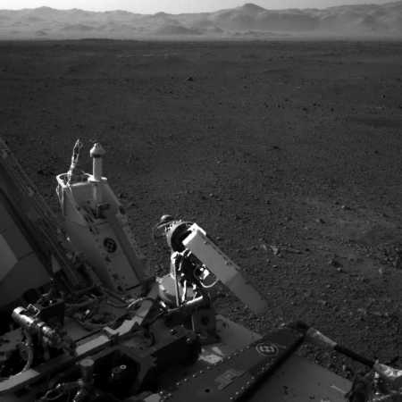 Curiosity on Mars looking at the rim of Gale Crater