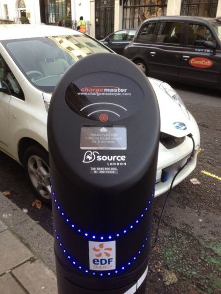 An electric car charging in central London.
