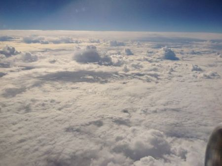 Looking out of an aeroplane window it is easy to see how significantly clouds reduce the flow of solar energy onto the Earth's surface.