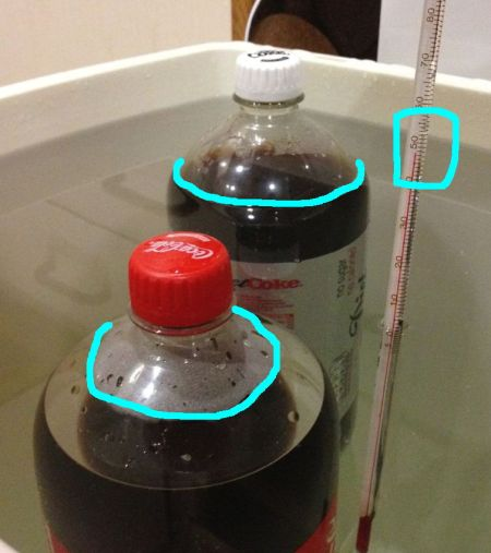 2 litre bottles of Coca Cola and Diet Coke both float in water - even when heated to 48 Celsius.