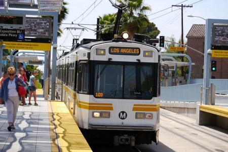 An LA Metro Train. Teh station has been built in the centre lanes of one of the wide Boulevards.