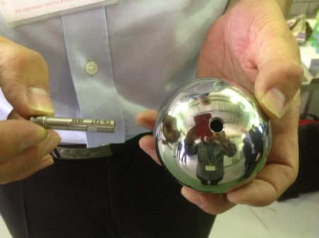 A colleague showing a very low level sample of known activity coudl be place inside a hollow steel ball,simulating radiation trapped inside steel pipes.