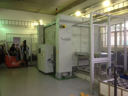 The low radiation chamber at UJV Rez At teh far end you can see a fork lift truck loading a pallet which will travel through teh chamber and emerge at this end.