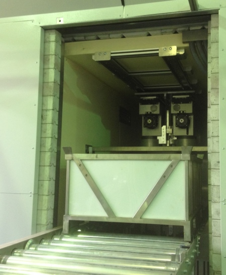 The sensitive radiation detectors can be seen inside the room as the doors open to allow the entry of test pallet.