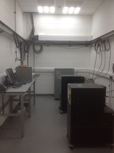 The black box at the back of this room is the 'hydrogen maser' which is the source of 'The time from NPL' (TM). The box in the foreground is the first of multiple back-ups