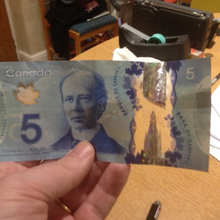 Canadian dollars are printed on plastic. That means they are see-through ans washable!