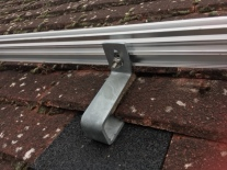 Detail of the attachment of horizontal rails. The steel bracket is screwed into a joist.