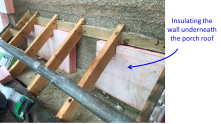 The porch roof was removed and insulation applied against the 'hidden' section of wall